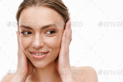 Image of caucasian young shirtless woman covering her ears with hands