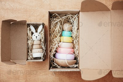 Stylish wooden toy for child in craft box on wooden table