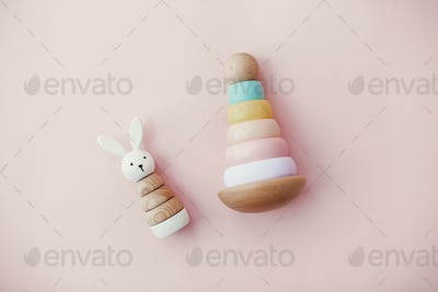 Modern colorful wooden pyramid with rings, wooden bunny and macrame rainbow
