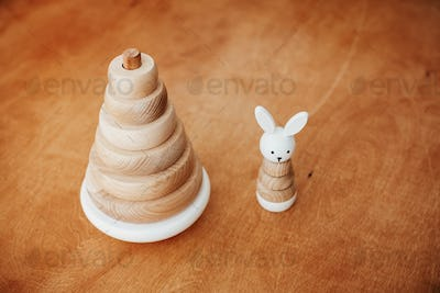 Modern simple wooden pyramid with rings