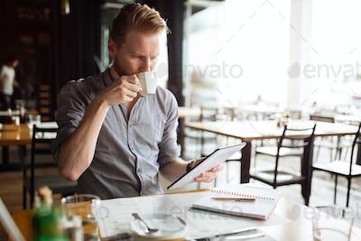 Businessman reading on break