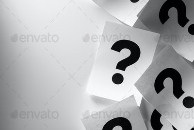 Border of printed question marks on paper