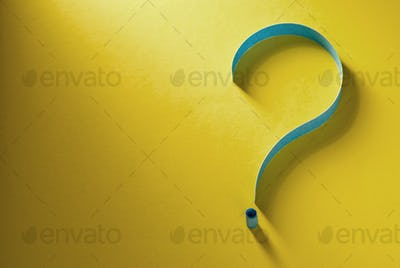 Question mark of coiled blue paper on yellow