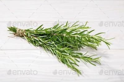Fresh Rosemary on white wooden background