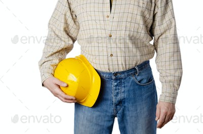 caucasian contractor weared in blue jeans and shirt holds yellow hard hat