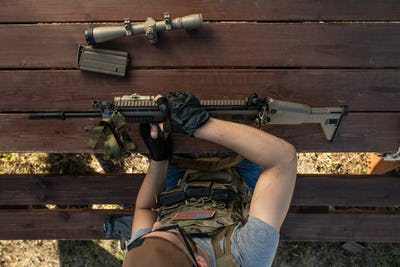 American man preparing for shooting