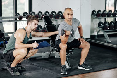 Man doing biceps exercise under control