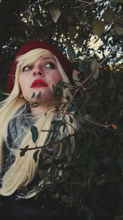 Young blonde woman alone in a forest in autumn
