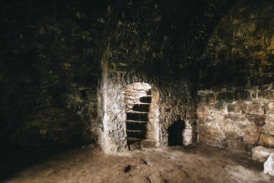 Destroyed ruined brick walls and window light in dark indoors