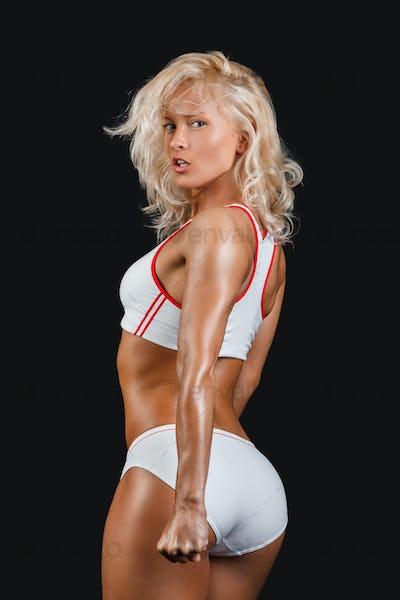 Sporty woman in a white sportswear.