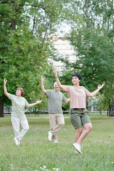 Practicing qigong with instructor