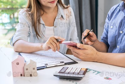 Young couple looking for comparison information on their decision to buy a new home