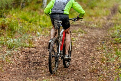 dirty man cyclist riding mountain bike