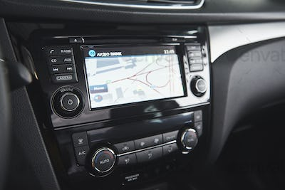 Luxury car Interior - steering wheel, shift lever, dashboard and computer