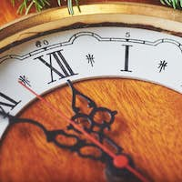 Happy New Year at midnight 2018, Old wooden clock and fir branches