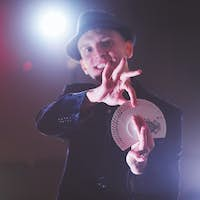 Magician showing trick with playing cards. Magic or dexterity, circus, gambling