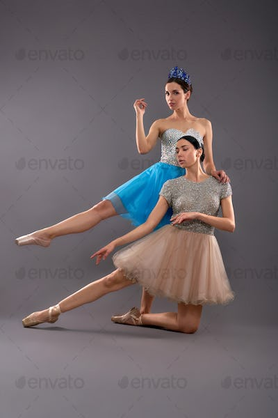 Front view of young female dancers posing in studio
