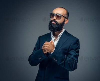 Portrait of bearded male in a business suit.