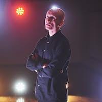Bald man standing indoors