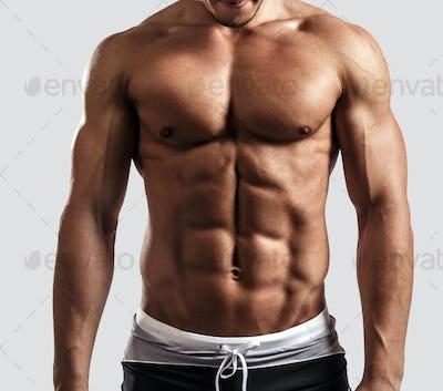 Portrait of muscular guy.