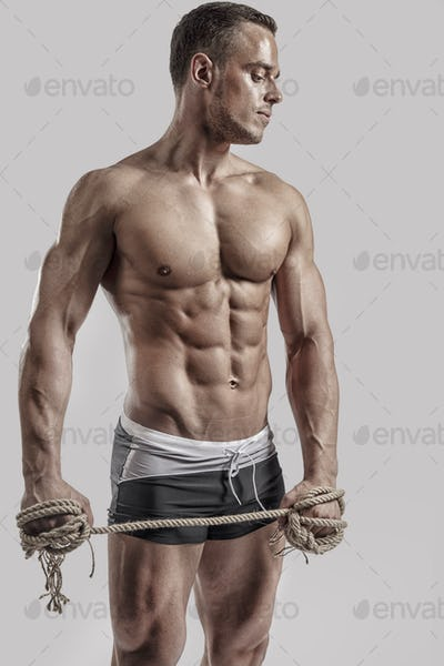 Fitness man posing in studio
