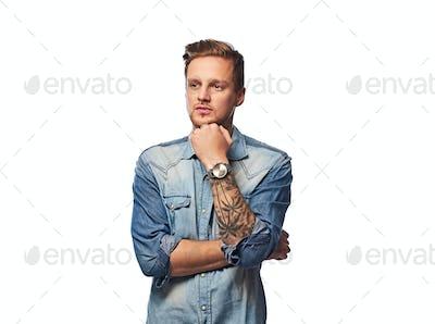 A man dressed in a denim shirt.