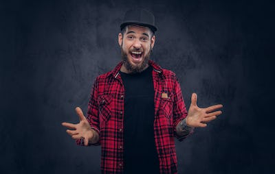 A bearded stylish hipster male with a tattoo.