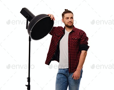 Lighting director isolated on white background.
