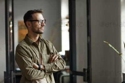 Pensive man standing at office