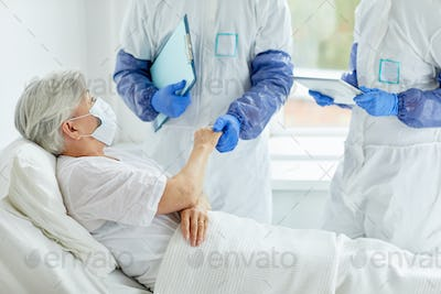 Two Doctors And Senior Patient