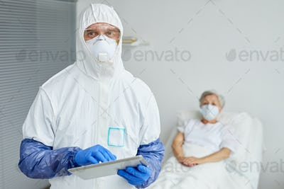Doctor Using Digital Tablet At Work