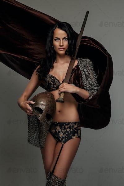 Sexy brunette woman in fluterring dress.
