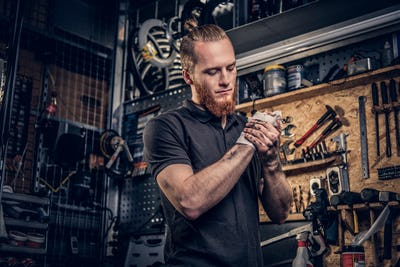 Mechanic cleans his arms after bike service manual.