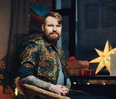 A man  in a room with Christmas decoration.