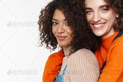 Portrait of cheerful multinational women smiling and hugging