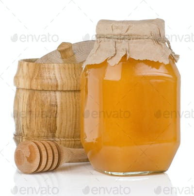 glass and wooden jars full of honey isolated on white