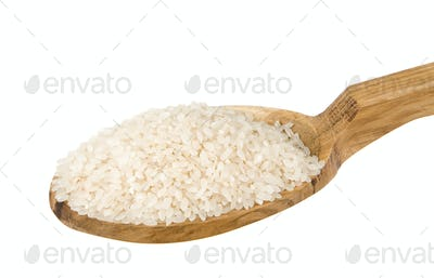 raw rice seed in wooden spoon isolated on white