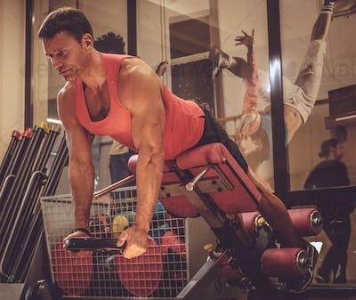 A man doing workouts in a gym club.