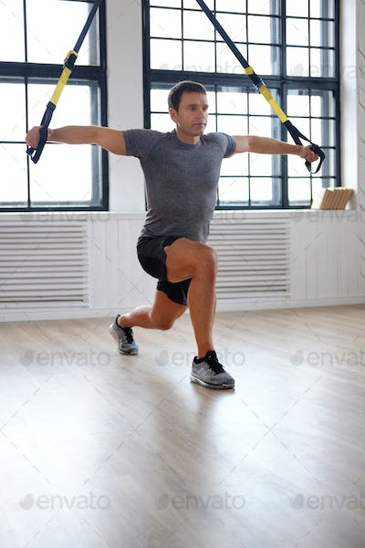 Middle age man doing fitness workouts.
