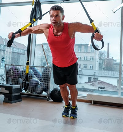 A man training with gymnastic rings.