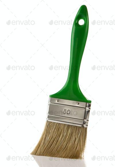 green paintbrush isolated on white
