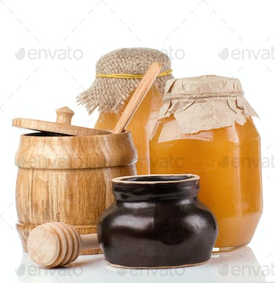glass, ceramic and wooden jars full of honey