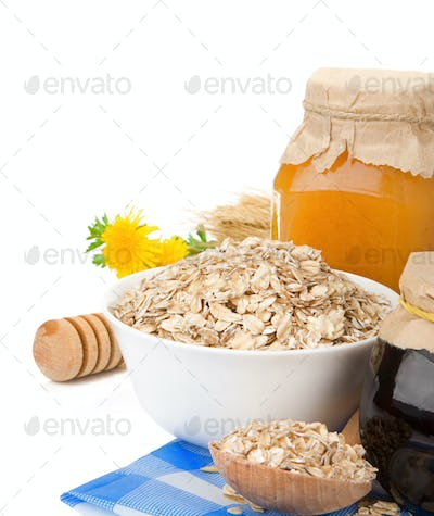 cereals with honey and oatmeal isolated on white