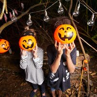 Kids with pumpkin faces
