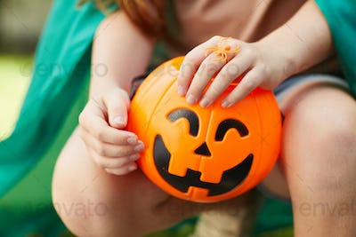 Girl with toy pumpkin