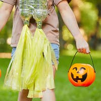 Girl with pumpkin bags
