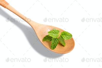 Peppermint aromatic herb on wooden spoon