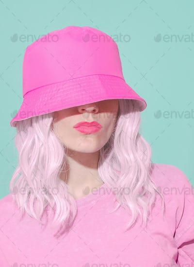 Fashion aesthetic girl in trendy summer accessories. Pink Bucket hat.