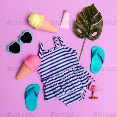 Vacation beach mood. Ice cream, flip-flop, sunglasses, swimsuit. Minimal flat lay art