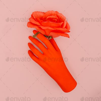 Fake red hand and roses. Minimal art. Congratulation concept